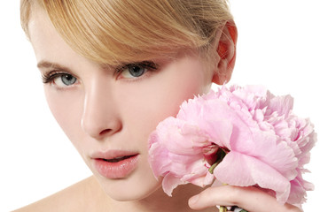 Young beautiful healthy blond girl with pink flower