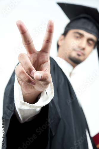 asian boy graduated holding victory sign