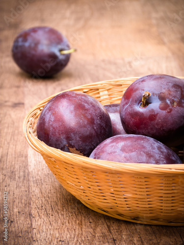 Plums in Basket on Table