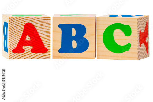 Wooden alphabet blocks isolated on white background. ABC letters