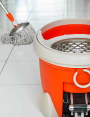 Rotary mop and bucket on tile floor