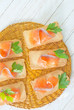 toasts with salmon and parsley