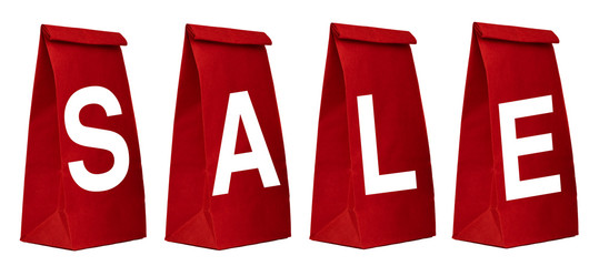 Red paper bags with SALE sign isolated on white background