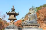 statue of buddha at shinheungsa temple poster