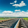 railroad closeup to cloudy horizon