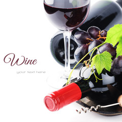 Bottles of red wine with fresh grape