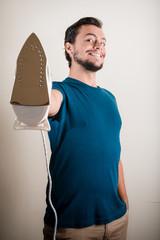 young stylish man housewife ironing
