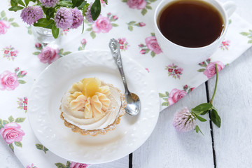 Tart with whipped cream and a cup of tea