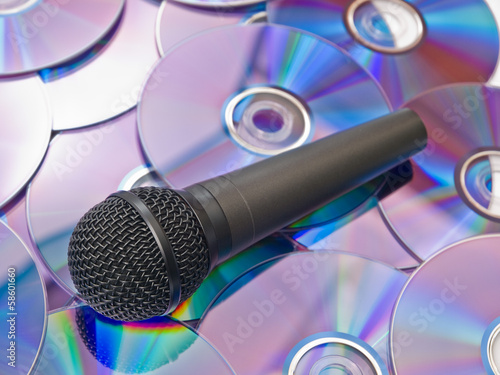 Black microphone on the background of disks