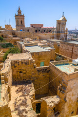 Roofs of the citadel in Gozo with the cathedral in the back