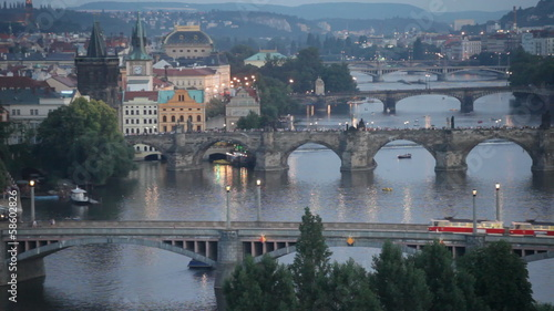 Tram passes on the bridge through Vltava in Prague, the Czech Re