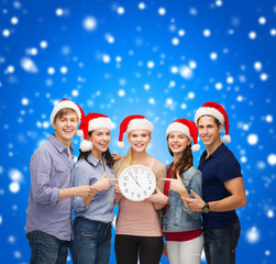 group of smiling students with clock showing 12