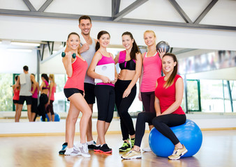 group of smiling people in the gym
