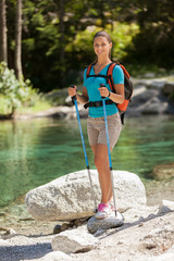 Beautiful woman with trekking outfit