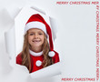 Happy little santa girl with teeth missing, smiling through hole