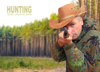 The hunter with gun aiming at you. Safety and insurance concept.