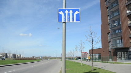 information road sign arrow indicates the direction of travel