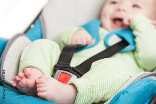 Little baby child in safety car seat