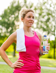 attractive blond woman with a water bottle