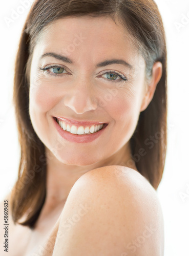 Woman in her forties with bare shoulders
