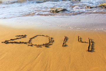 Date of new year on sand in surf