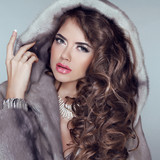 Beautiful brunette girl wearing in mink fur coat with long hair