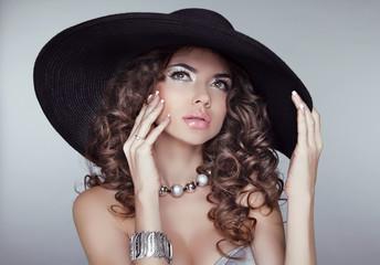 Beauty Portrait woman in elegant black hat. Wavy Hairstyle.  Sex