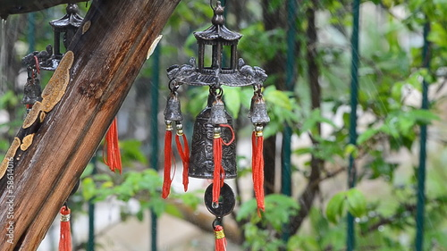 Feng Shui Chinese Bell and Coin in the rain