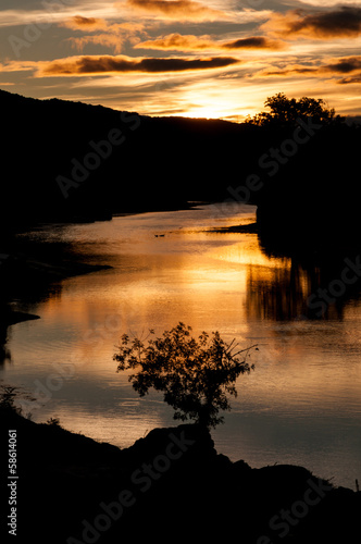 Great sunset on  river Gardon at Pont du gard vertical