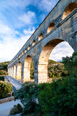 Side view of Pont du Gard and tourists path