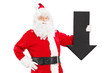 Smiling Santa Claus holding a big black arrow pointing down