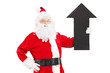 Smiling Santa Claus holding a big black arrow pointing up