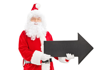 Smiling Santa Claus holding a big black arrow pointing right