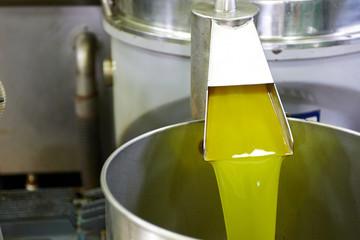 fresh oil flowing in the bin