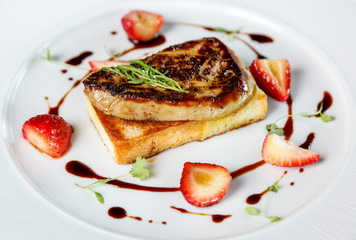 Fried foie gras with strawberry and sauce .