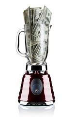 One hundred dollar bills placed in a blender