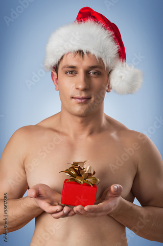 portrait of muscular men in santa cap