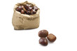 fresh group of chestnuts in a paper bag with three out
