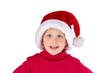 Cute little girl with Santa hat laughing