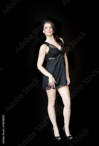 Young Woman with Beautiful Blue Eyes in Short Black Negligee