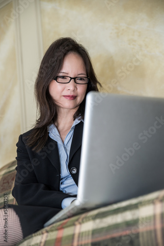 Woman on sofa on laptop