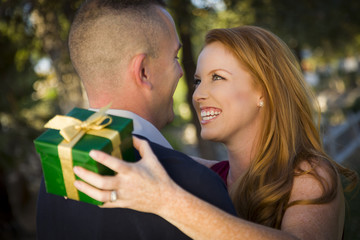 Beautiful Wife and Military Husband Exchange Christmas Gift