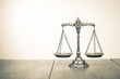 Law scales on table. Symbol of justice. Sepia photo