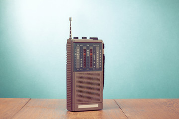Retro old radio receiver on mint green background