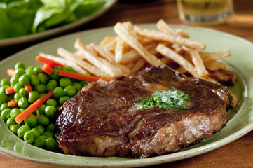 juicy ribeye steak with vegetables