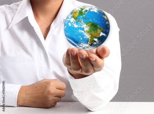"""earth in human hand """"Elements of this image furnished by NASA"""""""