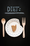 dieting concept image, piece of bread on a plate