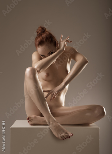 Photo of nude-naked beautiful woman in studio