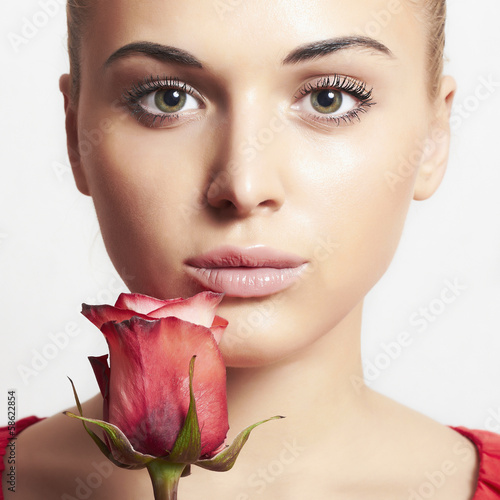 beautiful blond woman with flower.girl and rose.tender