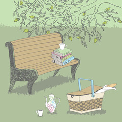 Bench in park and picnic basket